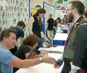 John Barrowman meets a fan at his autograph signing in the Sails.